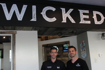 Brothers Andrew, left, and Nicholas Norton teamed up to open their second West Boylston Street eatery, Wicked Wing Co. (they are franchisees of Wild Willy's Burgers since 2012).