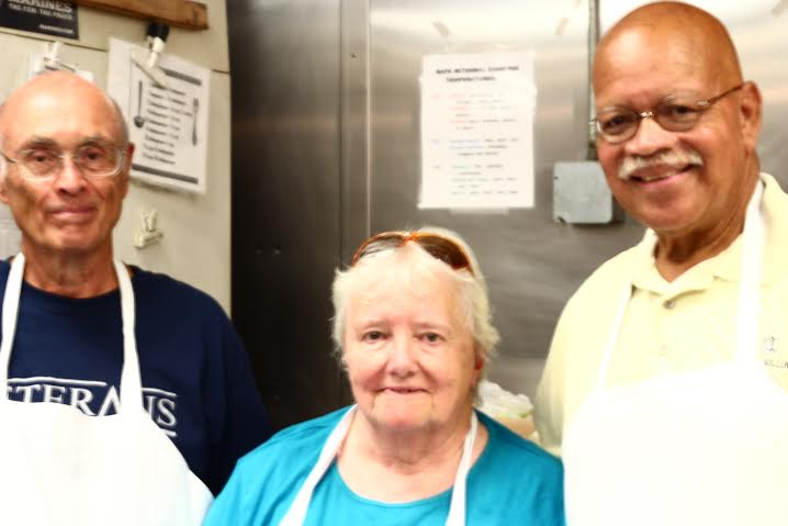 All Saints volunteers, from left, Jerry Lagueux, Beverly Heath and Larry Schuyler served dinner to displaced veterans Thursday, Sept. 17, at Veterans Inc. on Grove Street.