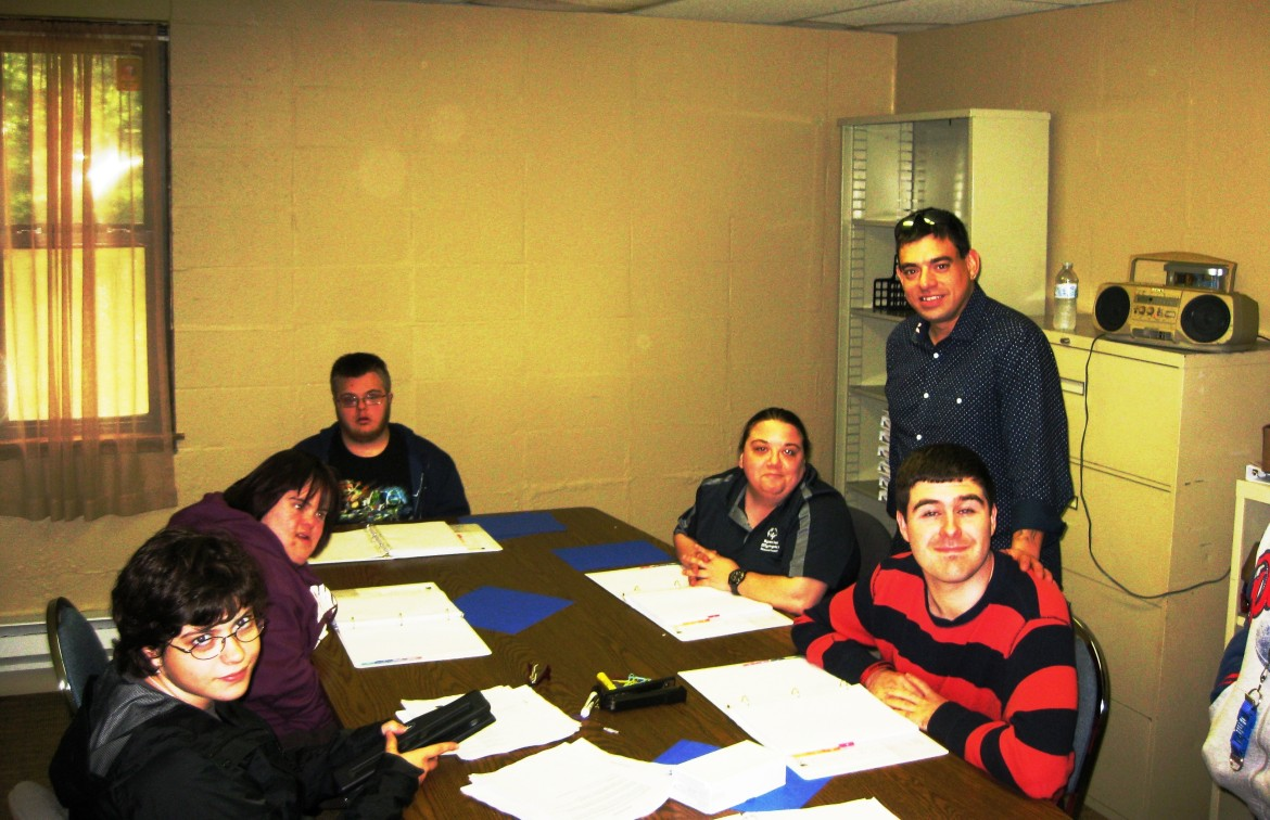 James Acker, employment programs manager, stands with Seven Hills Aspire!'s first Up and Out class.