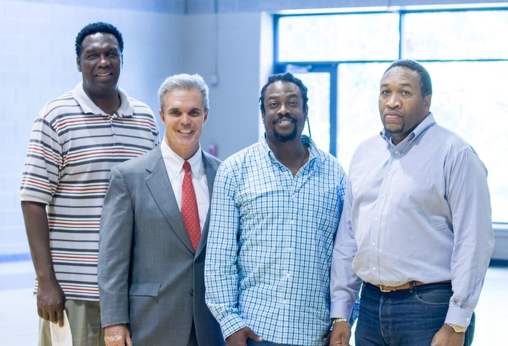 From left, Ernie Floyd of Pride Productions, Worcester District Attorney Joseph Early, Ike McBride of the Boys & Girls Club, and Charles Luster of the Worcester Youth Center at the Unity in the Community Increase the Peace event in September.