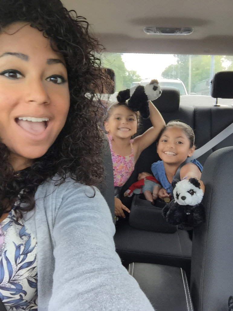 Giselle Rivera-Flores and her daughters, Evian, left, and Brooklyn are on the go ... as usual.