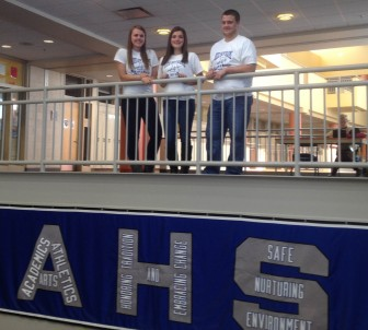 AHS Leadership Ambassadors, from left, Samantha Moreau, Emily Sarkisian and Conor Scully model Run for a Rocket T-shirts at Auburn High.