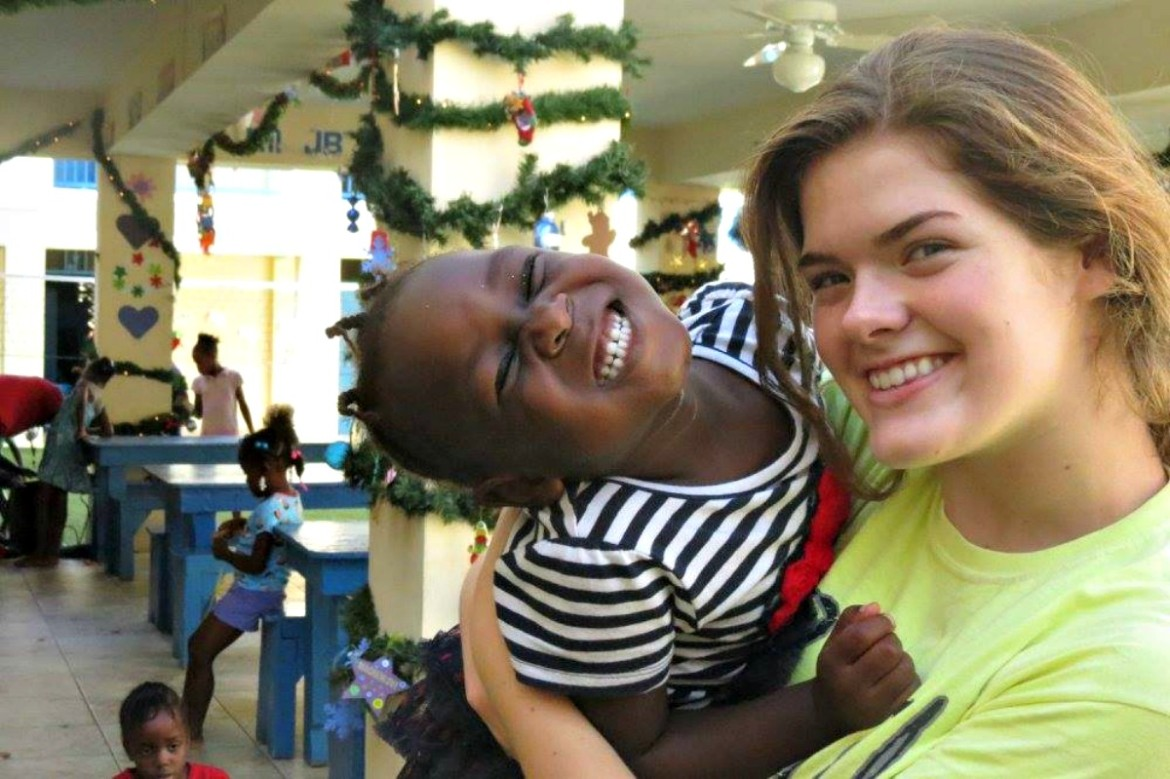 Clark traveled to Haiti to help rebuild homes and promote hygiene education.