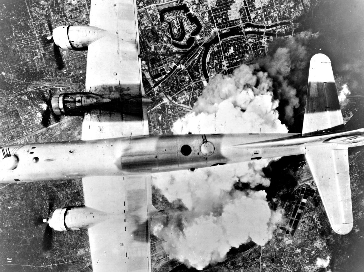 A B-29 Superfortress flies over the destruction of Hiroshima