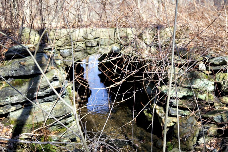 Old stone bridge on abandoned rail bed