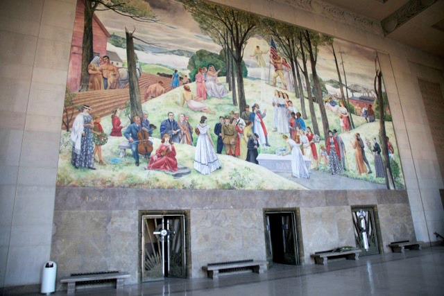 Leon Kroll mural featuring city residents inside the Aud.