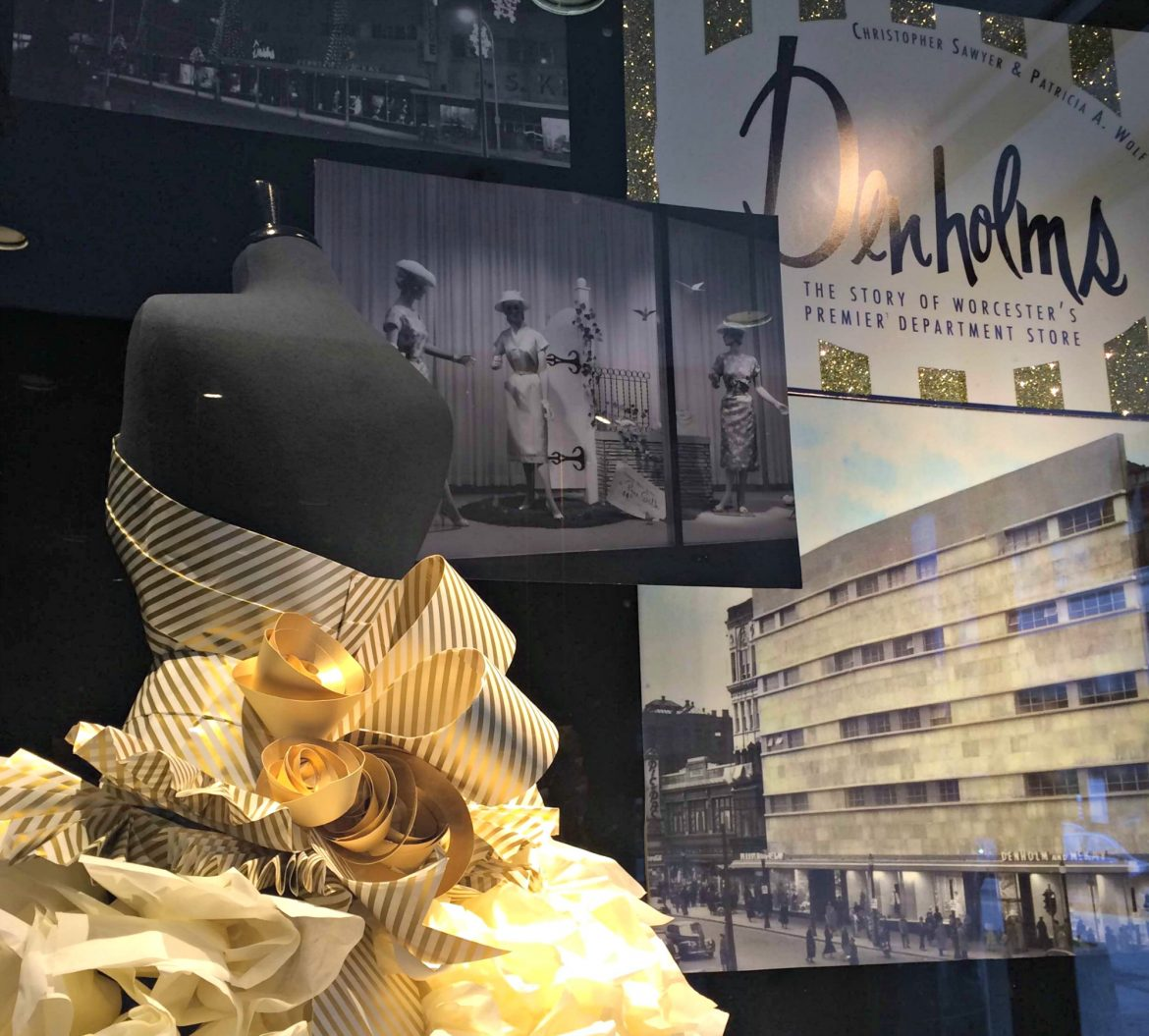 The window displays at the Denholm Building not only dress up the Main Street landmark's facade but also highlight the building's history.