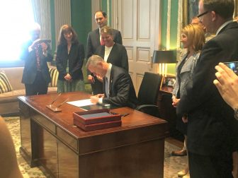Surrounded by legislators and advocates who helped craft the bill, Gov. Charlie Baker signed into law June 3 the first significant overhaul of the state's public records law in more than 40 years.