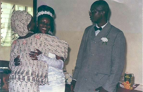 Theresa and Augustine receive well-wishers at their wedding.