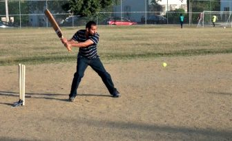 Sheraz Ali prepares to swing at cricket practice recently at Holmes Field.