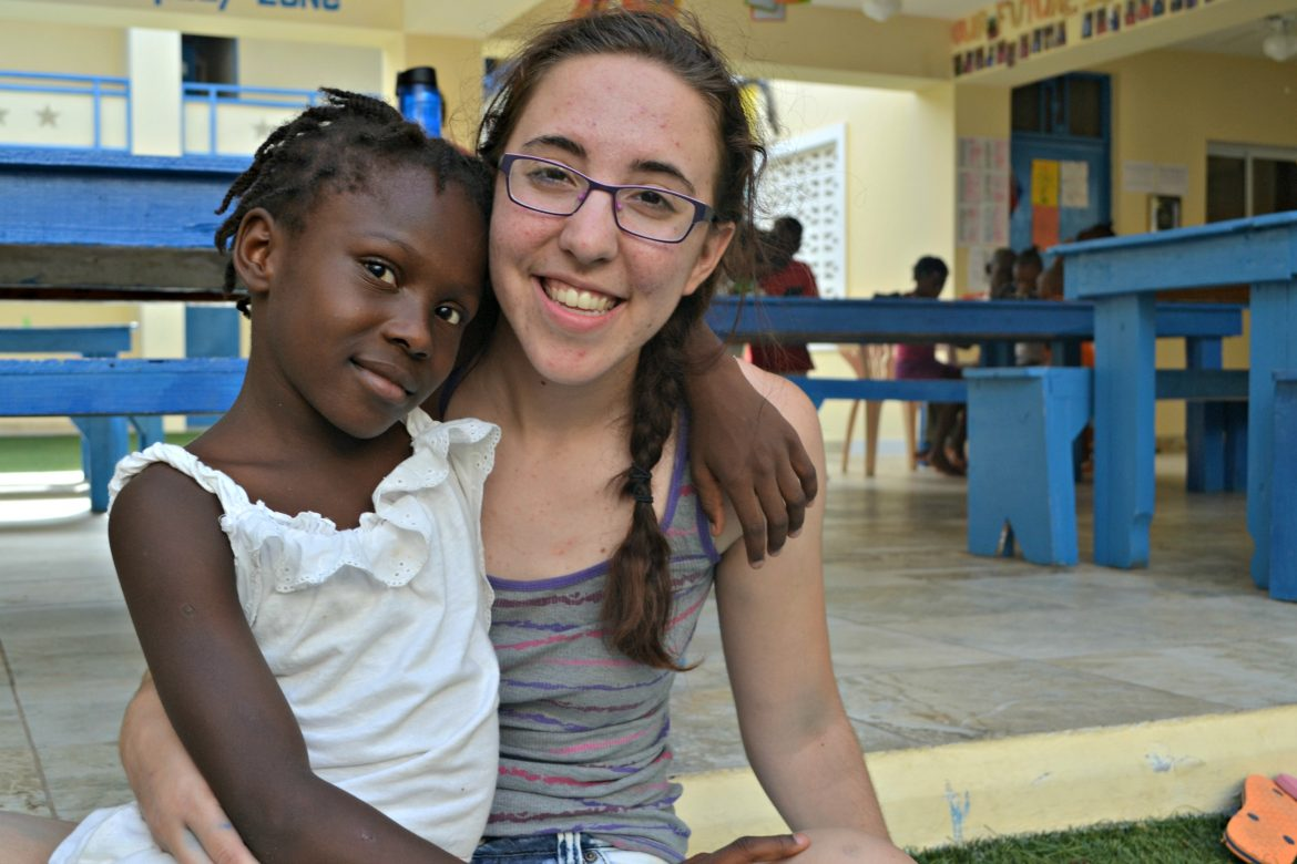 Danielle in Haiti last year with one of the Be Like Brit kids.