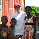 With Haitian children, including Faga, second from right
