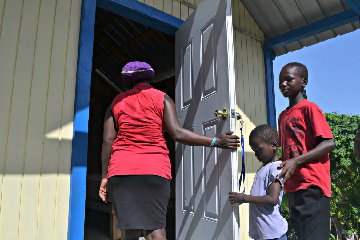 House Blessing Day -- the mother opening her door for the first time to her first ever home.