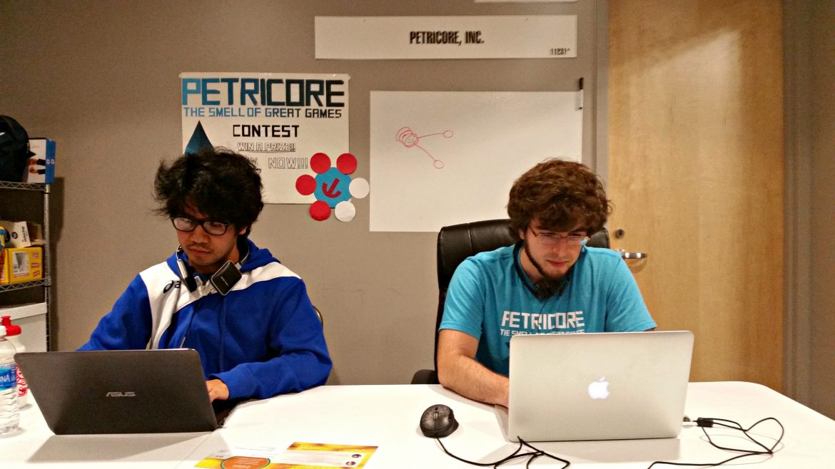 Oliver Awat and Chris Bruno work on Petricore's newest project.