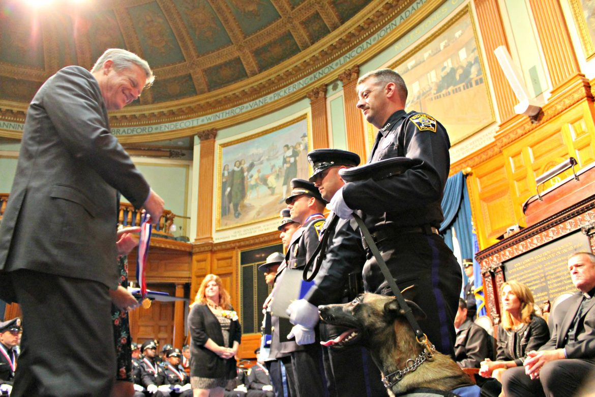 Officer Jared MacDonald, right, of the Bourne Police Department received the Trooper George L. Hanna Medal of Honor on Thursday, the highest award that can be given to a police officer in Massachusetts.