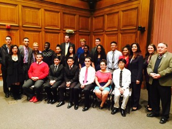 Kathy Esparza and Caleb Encarncion-Rivera, second and third from left, pose with Y4D4's second cohort of teen activists -- along with city officials, among them City Manager Edward M Augustus (third row, left) and District 4 Councilor Sarai Rivera (third from right) during a ceremony at City Hall last November.