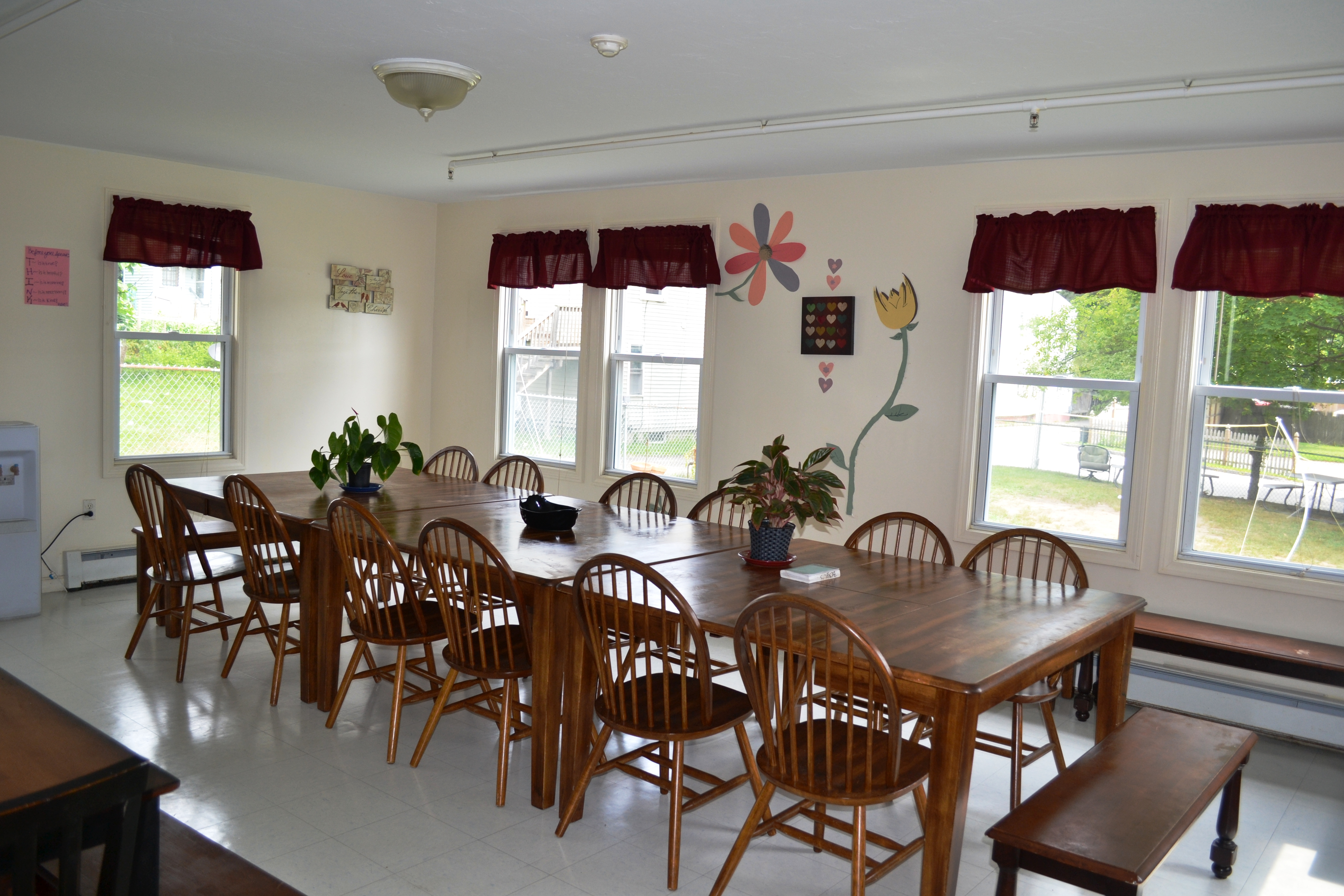 The dining room, with its expansive table, is situated to ensure all have a place at the table for dinner.
