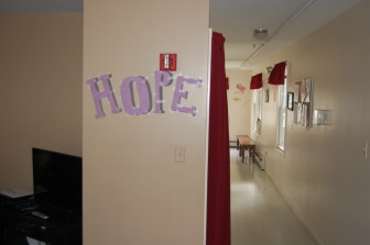"A literal sign of ""Hope"" greets individuals as they make their way to the kitchen at Beryl's House for women in recovery."