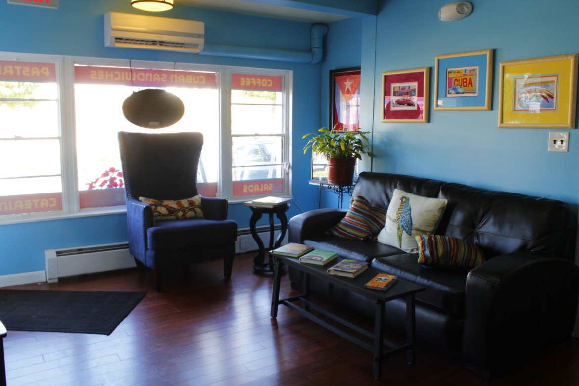 The lounge area at Cafe Reyes is decorated with bright colors and Cuban accents.