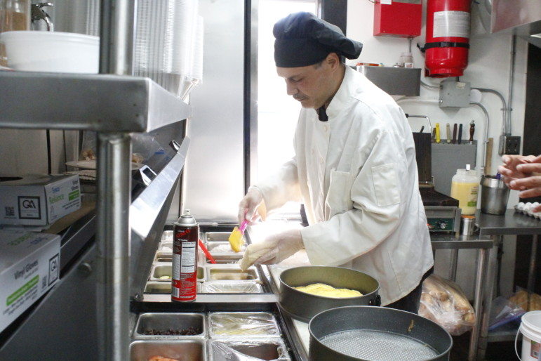 Louis Torres, hard at work in the Cafe Reyes kitchen, where he's risen to chef.