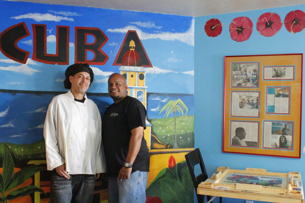 Chef Louis Torres, left, and waiter Rey Ortiz are in recovery and proof of the impact Cafe Reyes can make.