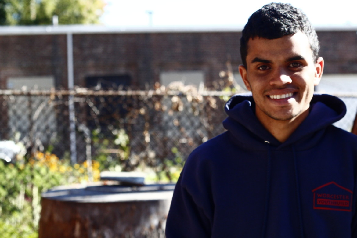 Marcus Diaz, 21, has gained much more than a menial job by working on the YouthBuild aquaponic greenhouse project with Stone Soup and Worcester Roots Project.