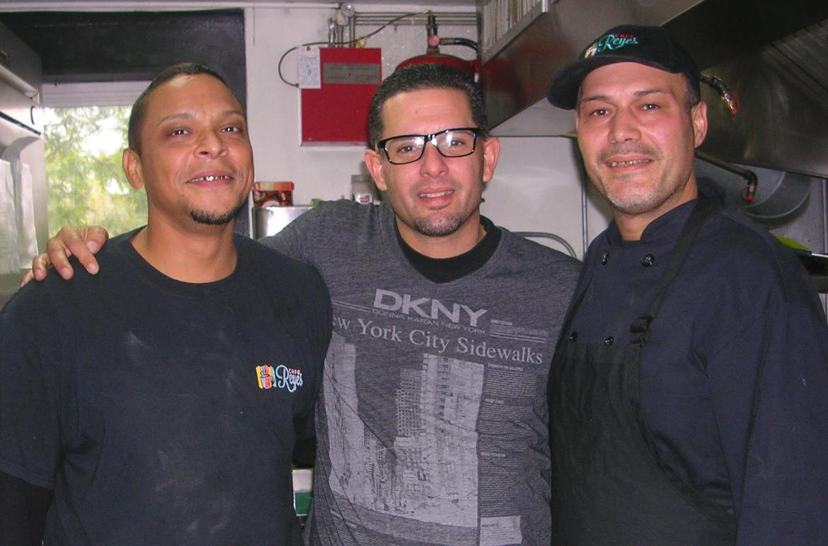 "Louis Torres, right, stands proudly with the men he referred to as his ""first"" and ""third"" kitchen trainees, Manuel Andino, left, and Gabriel Torres."
