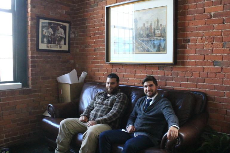 Lock 50 chef Tim Russo, left, and general manager Tom Studer spend a rare moment at rest amid their preparations for a January opening.