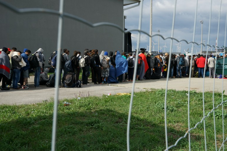 A line of Syrian refugees crosses the border of Hungary and Austria on their way to Germany in September.