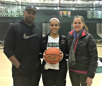 Wachusett basketball star Mya Mosley stands with her parents, Will Mosley of Worcester and Donna Gillogly, who captained the team at Worcester State.