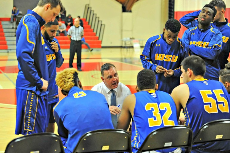Longtime Worcester State coach Dave Lindberg huddles up with his Lancers.