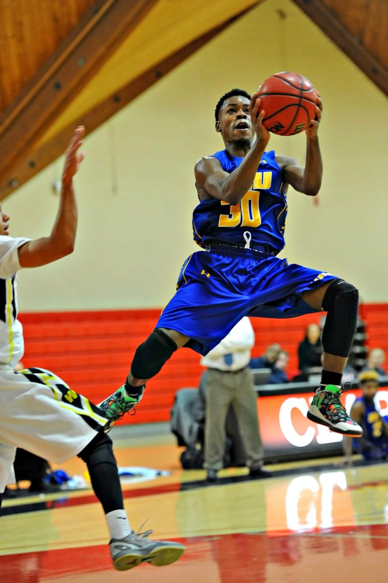 Bilal Shakir drives to the hoop vs. Wentworth Dec. 30. Shakir scored a game-high 22 in the Lancers' 81-66 win.