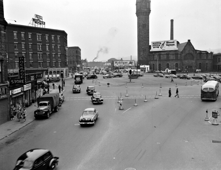 Looking east, in April 1950, from Foster Street (which once connected with Washington Square under the railroad bridge by St Vincent's) toward Shrewsbury Street. The old Union Station is directly in front, while the new station is off-frame to the right.