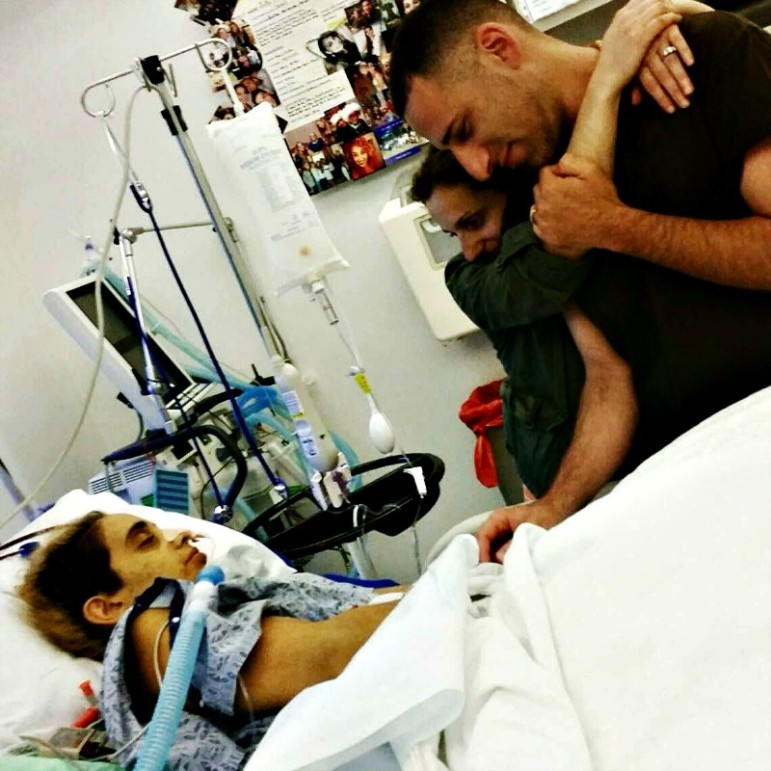 Siblings Mirella and Anthony, right, stand by Jully's side as she recovers during her 90-day hospital stay last summer.