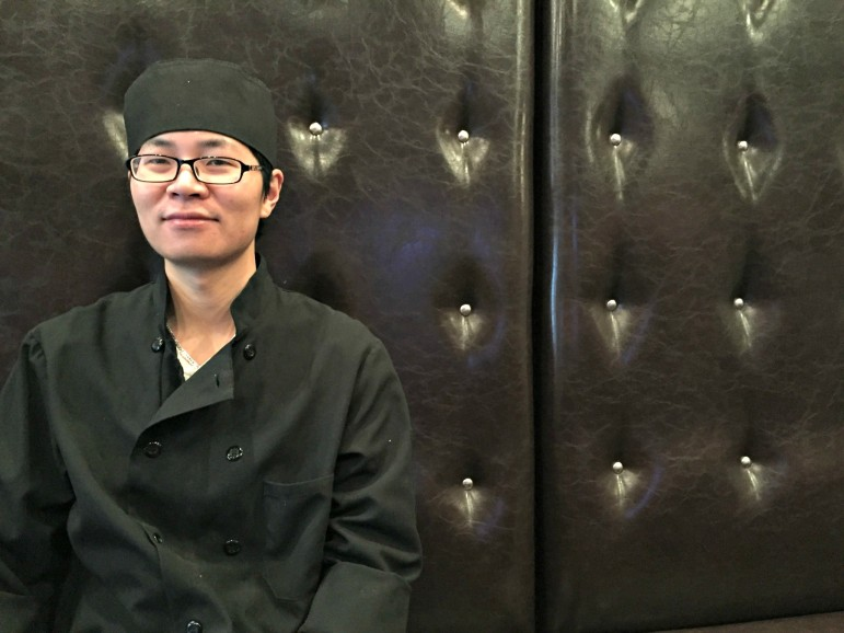 Ken Zhang, co-owner of Yummy Steak House, which opened in November.