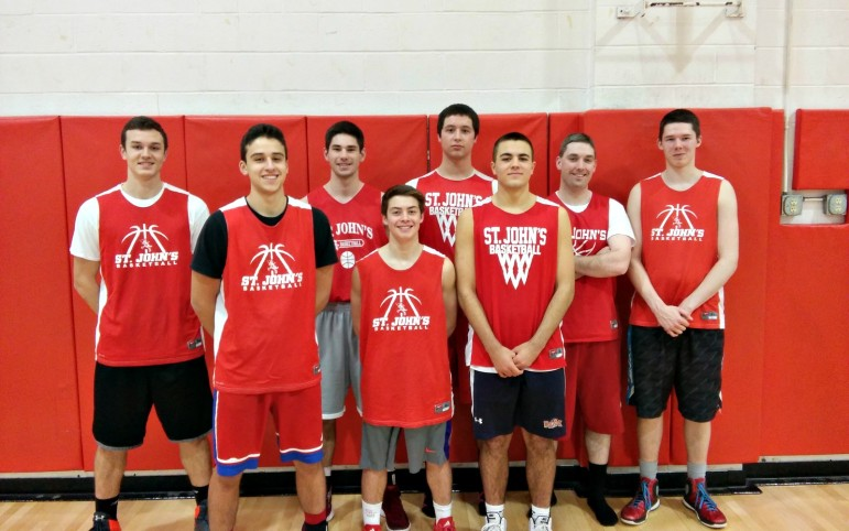 The St. John's boys basketball Red Team, from left, Jackson Emus, Matt Sacco, Joe Lewis, Bobby Duquette, Hunter Gorgas, Steven Bucciaglia, assistant coach Mike Curran and Will Goff.
