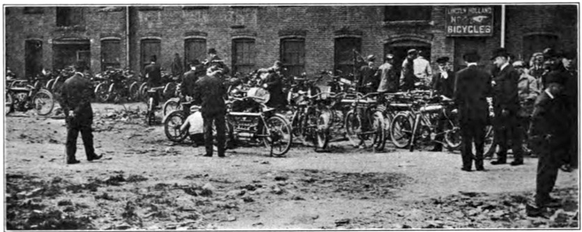 Riders gather in the yard of Lincoln Holland's Bike Shop on Allen Court, located next to the present day offices of Worcester Sun.