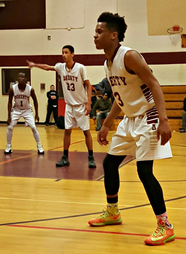 Tariq Massenburg eyes football in college, but the Doherty star more than holds his own on the high school hardwood.