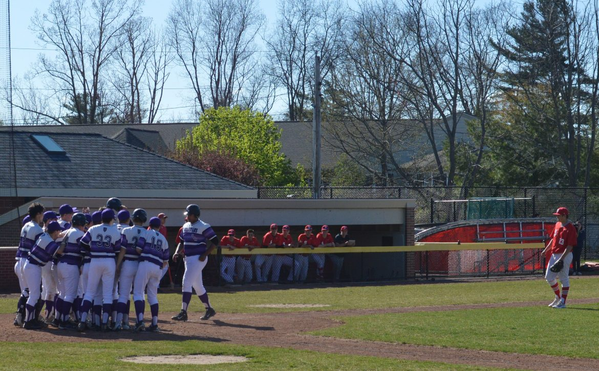 Jon Gonzalez is welcomed at the plate by teammates after his home run against St. John's May 9.