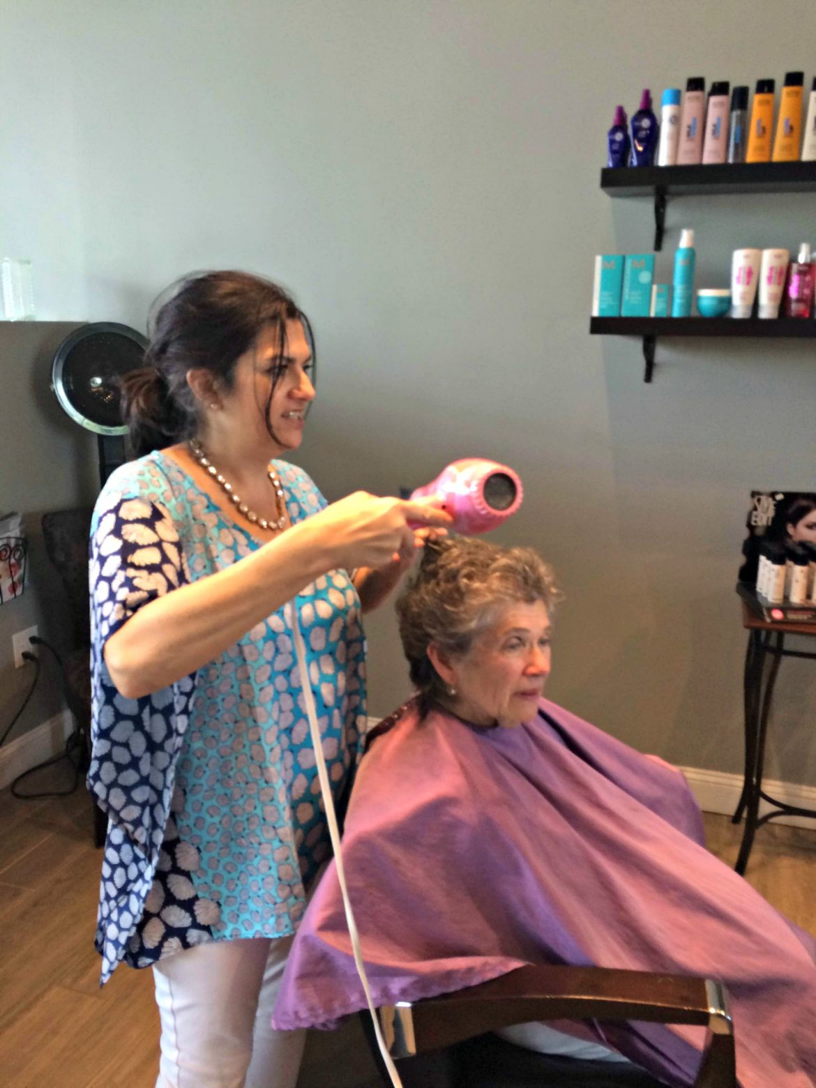 Stylist Gina Joubert works with a customer.