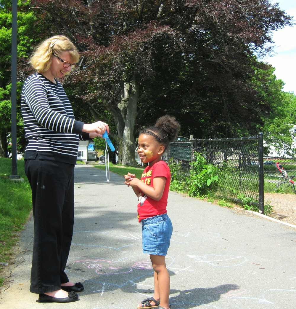 A Walking Together missioner connects with a youth at a University Park outreach event.
