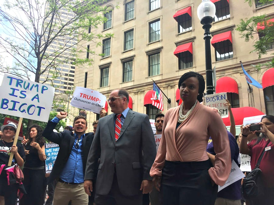 Congressman Michael Capuano and Boston City Councilor Ayanna Pressley join protesters outside a Trump event in Boston.