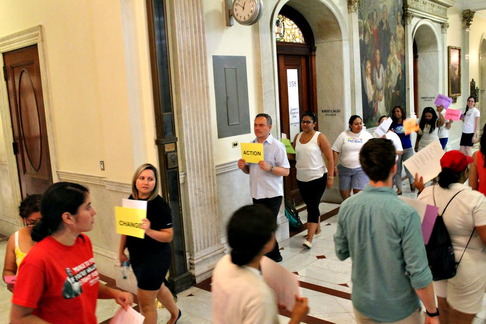 Immigrants and advocates protest inside the State House last week.