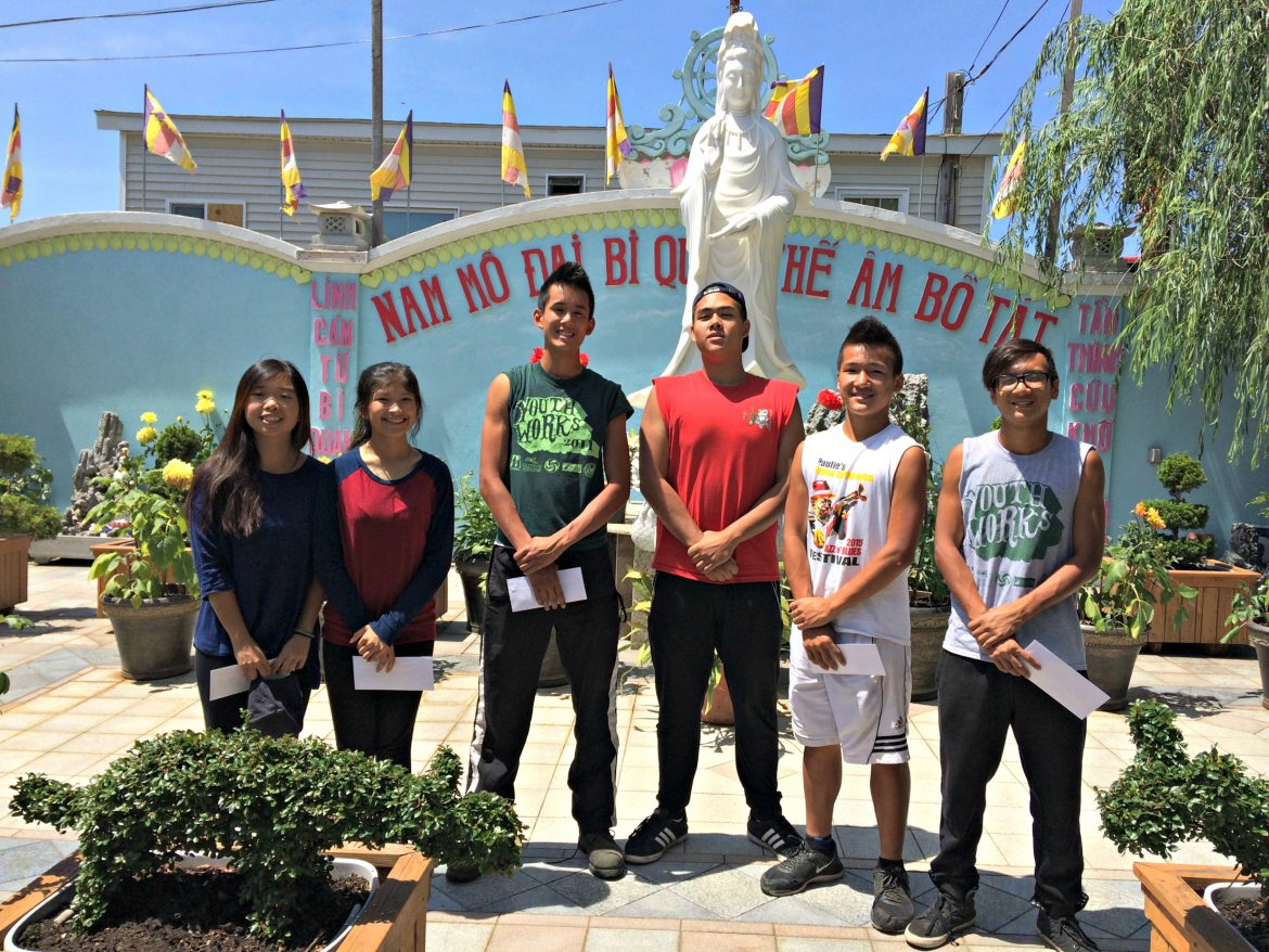 From left, YouthWorks employees Cathy Tran, Tracy Ho, Thien Hoang, David Kenchanh, James Nguyen and Thomson Tranphi pose in front of their summer workplace, Pho Hien Temple on Dewey Street.