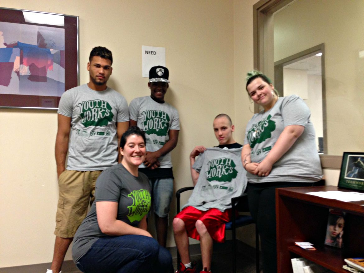 YouthWorks participants, from left, Bobby Harris, Jean-Carlos Gomez, James Fenner and Shelby Onstott, pose with case manager Lila Milukas.