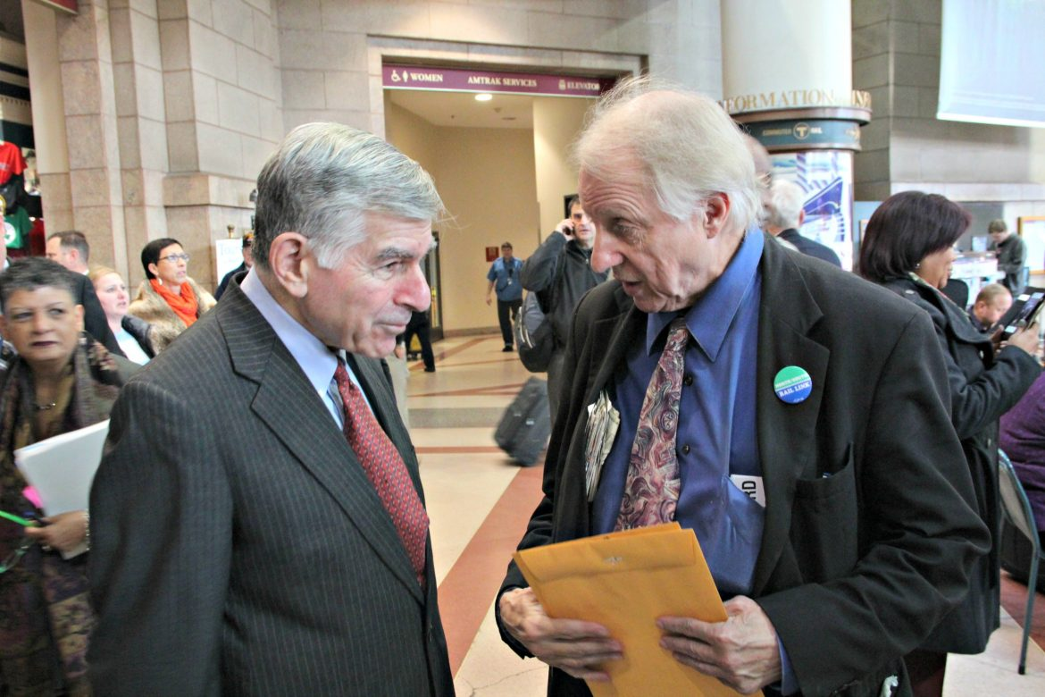 Former Gov. Michael Dukakis, left, (here with former Rep. John Bussinger) has strong feelings about Donald Trump and the impending election.