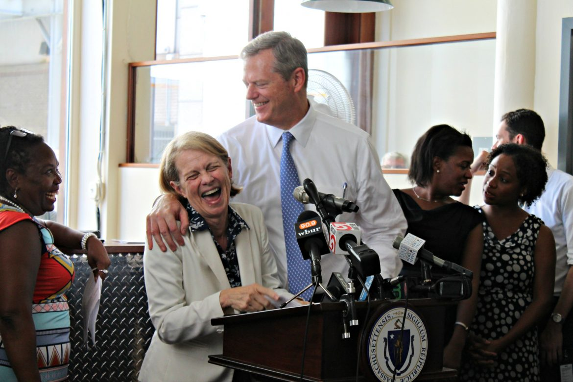 "Gov. Charlie Baker jokingly interrupted Sheila Dillon (center), director of the Department of Neighborhood Development for Boston, during her remarks celebrating a rental housing award announcement after she teased that funding ""hasn't come in yet"" for the next phase of redevelopment of 48 Boylston St."