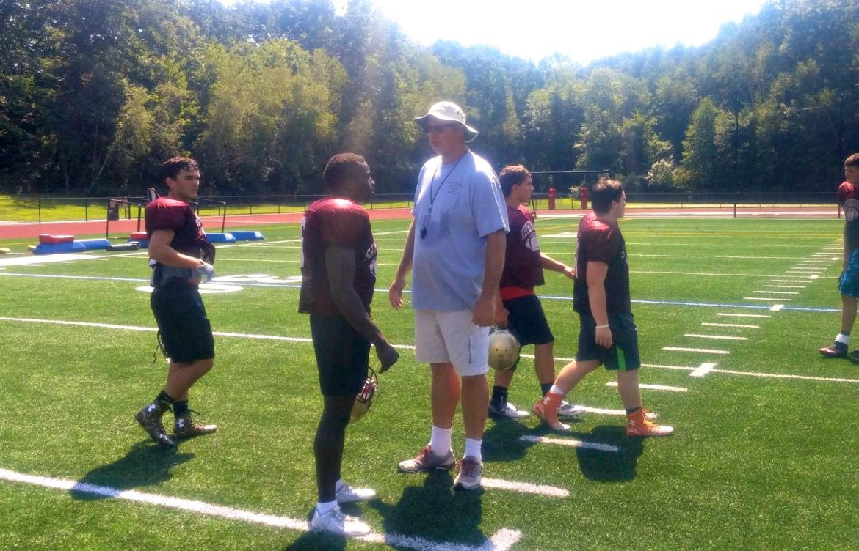 Kevin Mensah talks with Shepherd Hill coach Chris Lindstrom.