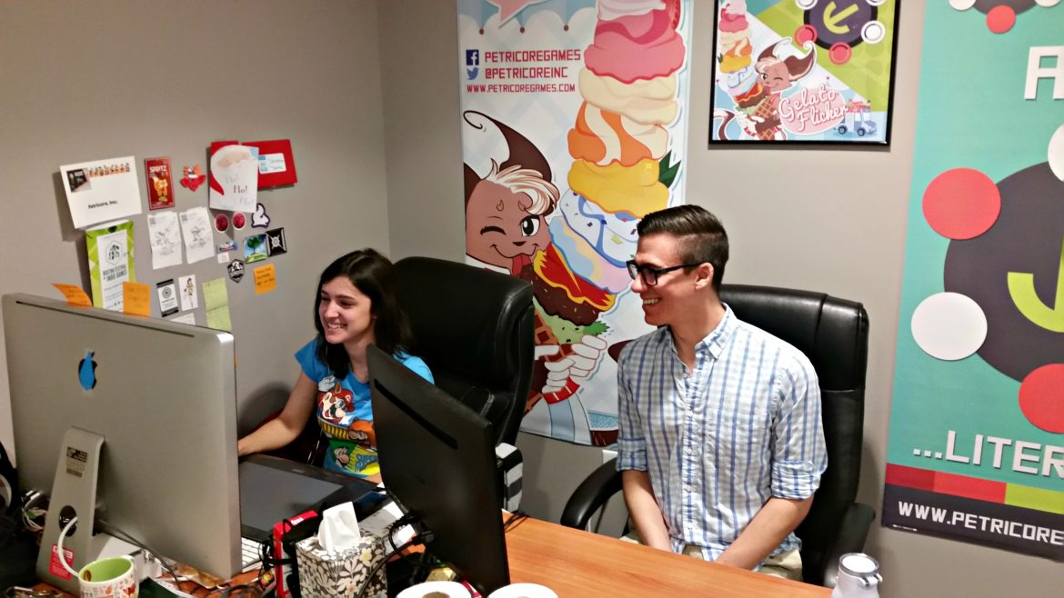 Petricore CEO Ryan Canuel works with lead artist Christina Andriano at the team's Franklin Street headquarters.