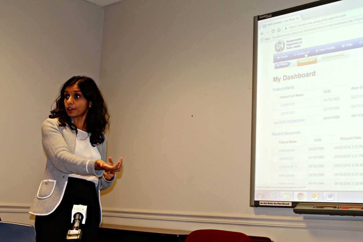 Department of Public Health Commissioner Dr. Monica Bharel demonstrates how the state's redesigned online Prescription Monitoring Program system will work once it officially launches in mid-October.